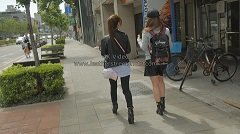 girls-in-leather-candid-wait